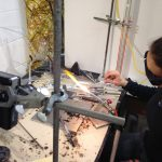 student using lava glass for glass blowing