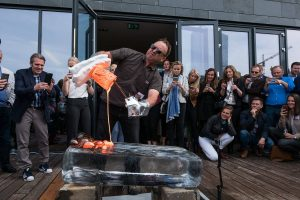 Bob Wysocki pours lava on a block of ice in Reykjavik to promote the Icelandic Lava Show.